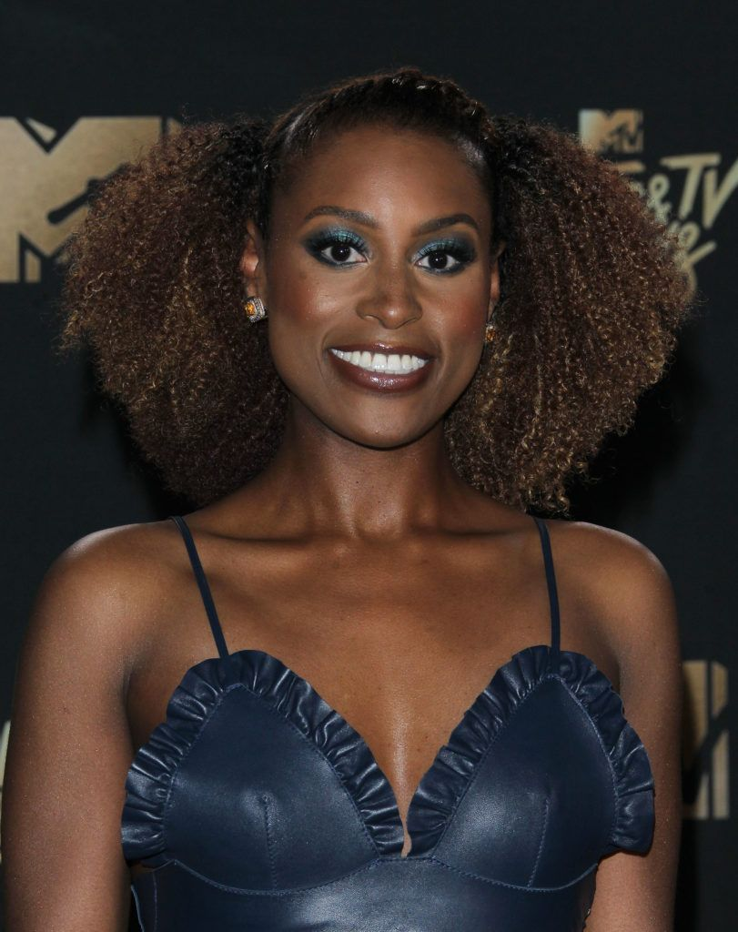 issa rae with chocolate hair afro wearing a blue dress at mtv awards