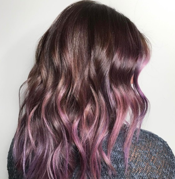 chocolate brown hair colour: backshot of woman with chocolate mauve hair