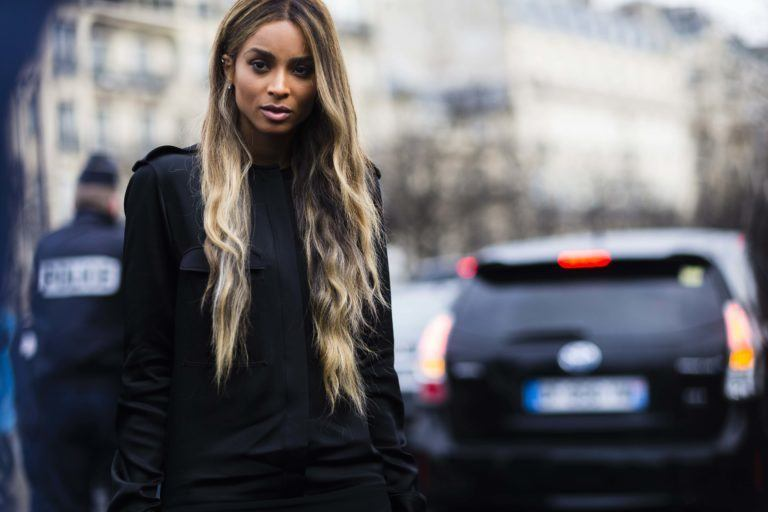 hairstyles for wavy hair: street style image of ciara with very long brown blonde ombre wavy layered hair