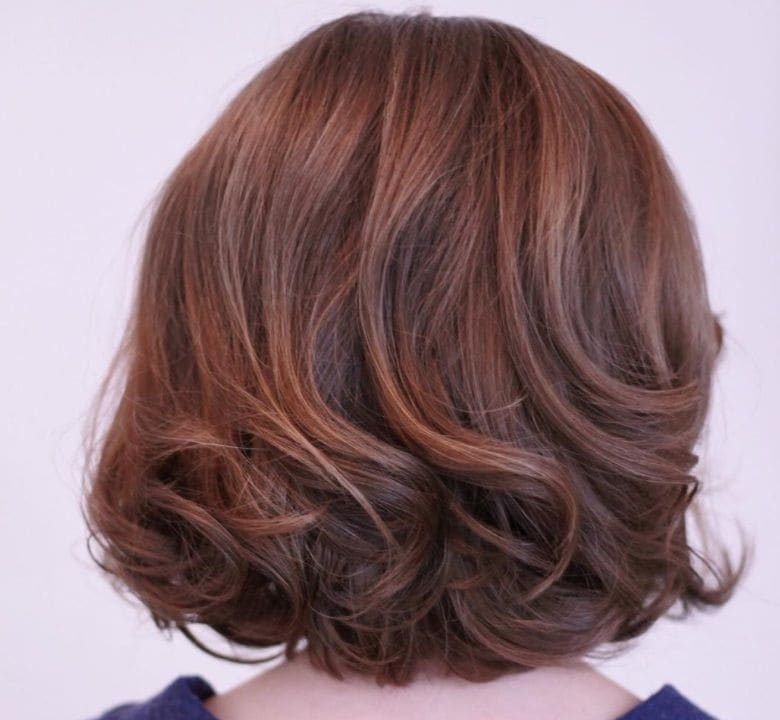 mother of the bride hairstyles for short hair: woman with short curled ends hairstyle