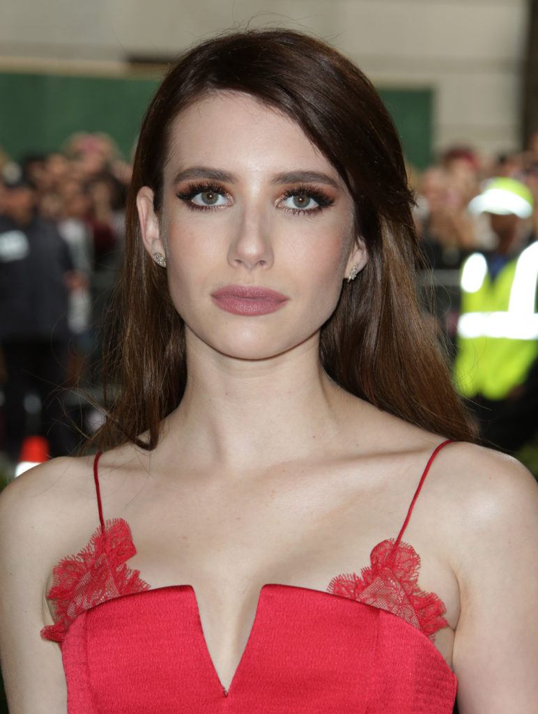 emma roberts with chocolate brown hair wearing red dress at met gala event