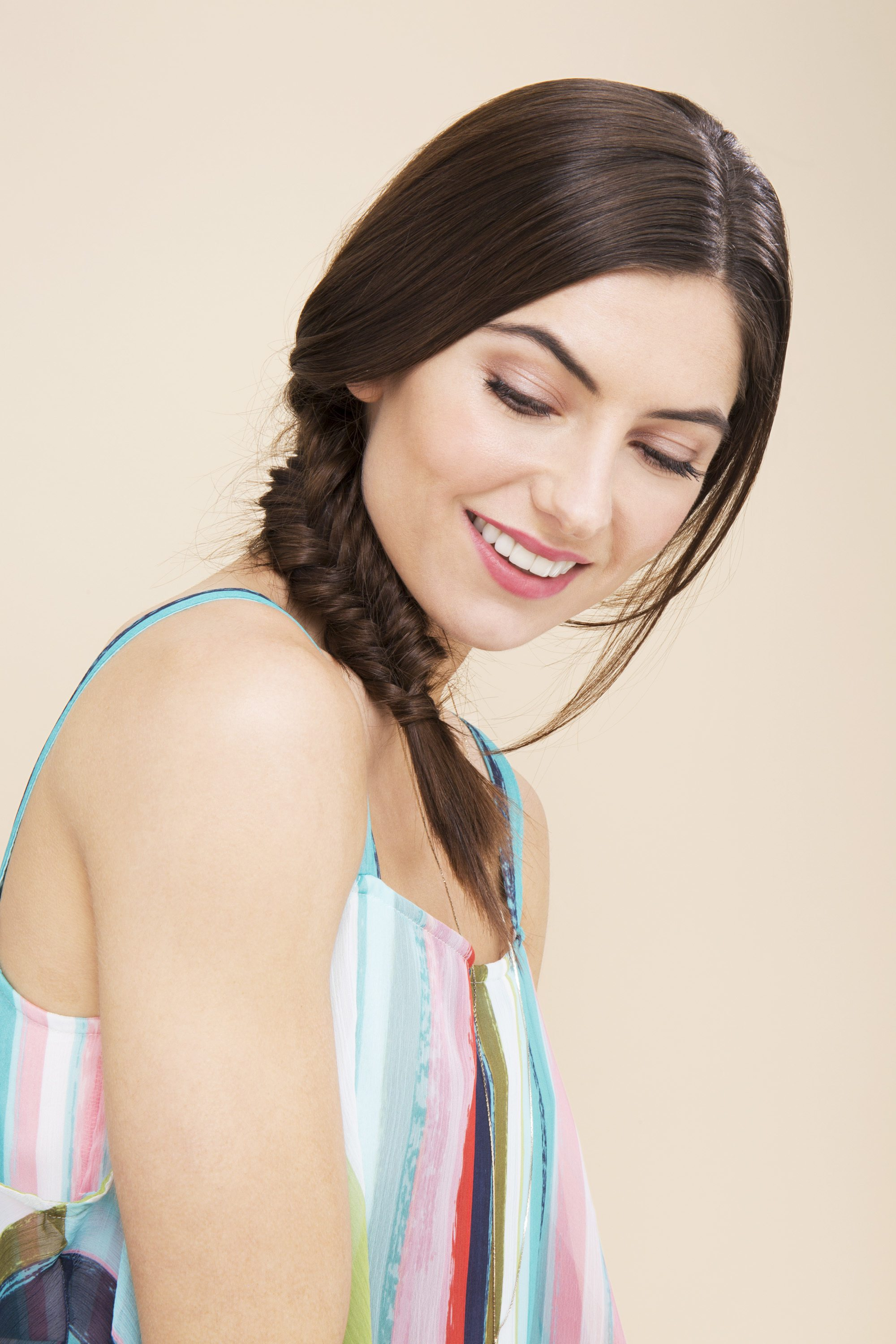 Brunette woman with a side fishtail braid