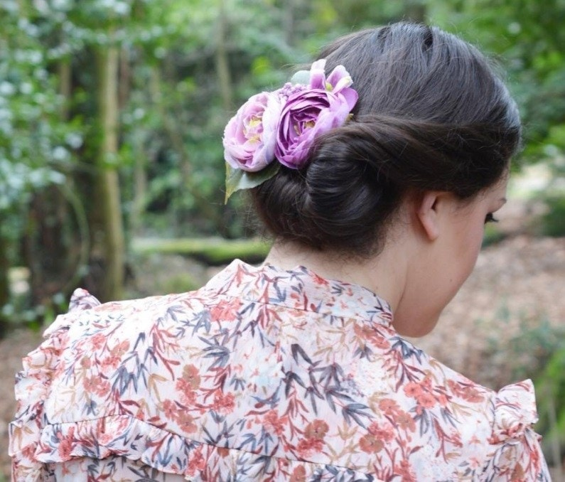 mother of the bride hairstyles: woman with gibson tuck hairstyle with flowers in her hair