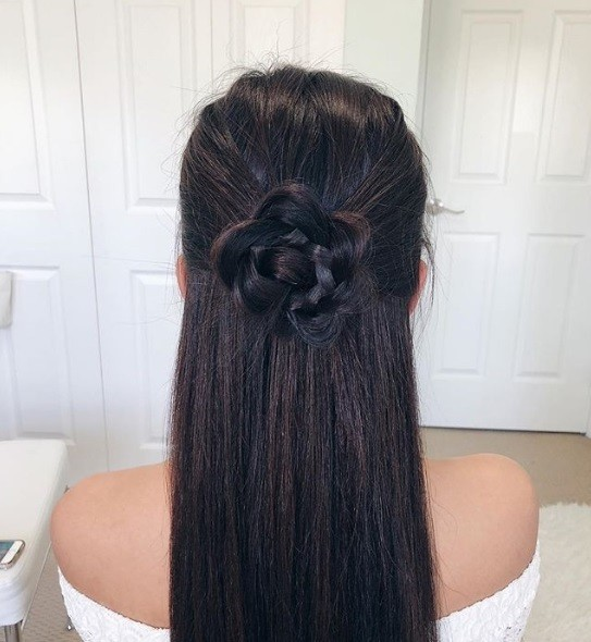 Boho hairstyles: Brunette long straight hair in a half-up half-down flower braid bun