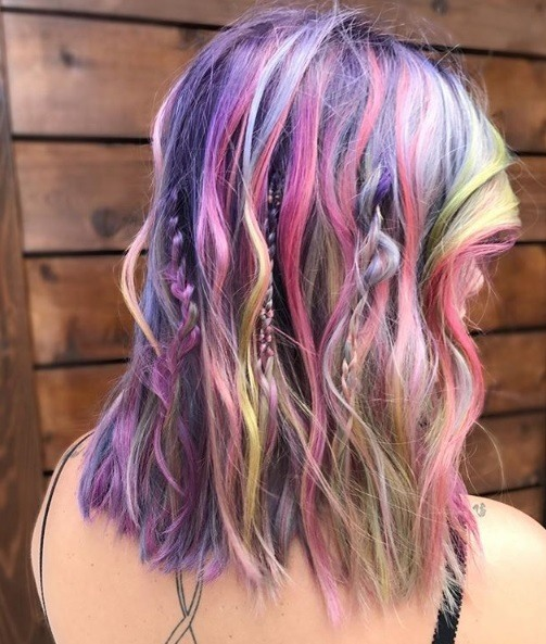 Boho hairstyles: Rainbow highlighted shoulder length wavy hair with hidden braids