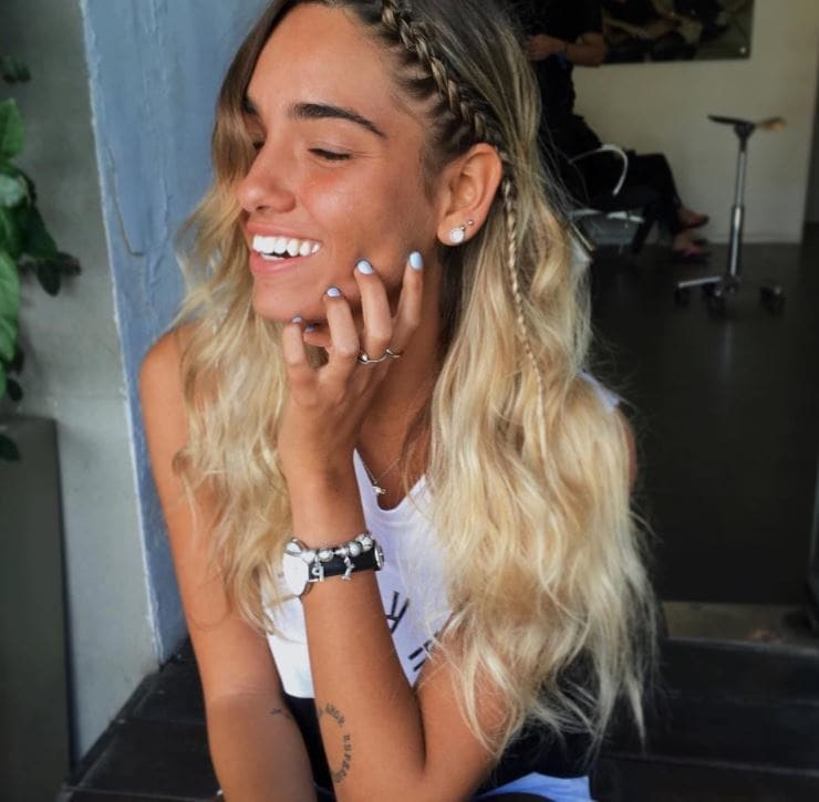 Long blonde beach waves hair with single braid from centre down to ear