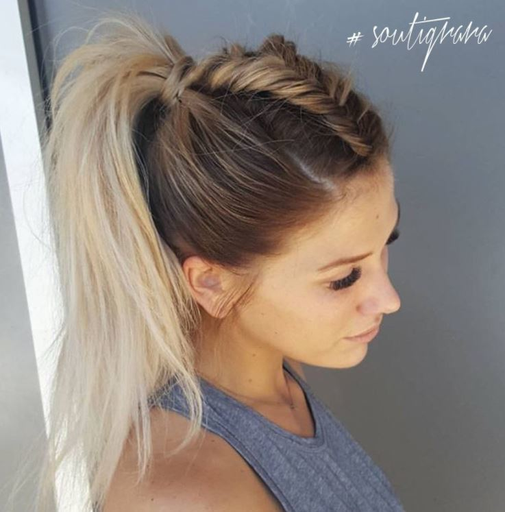 Brown to blonde ombre long hair in high ponytail with fishtail braid down the centre.