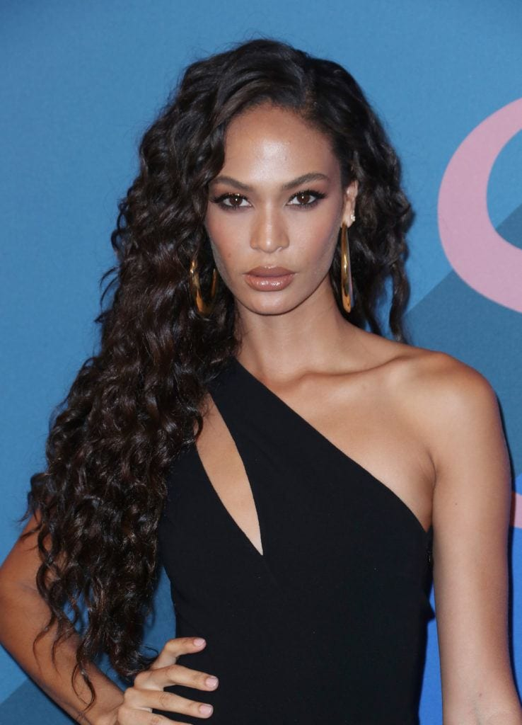 Joan smalls chocolate hair colour styled into curls at CFDA fashion awards