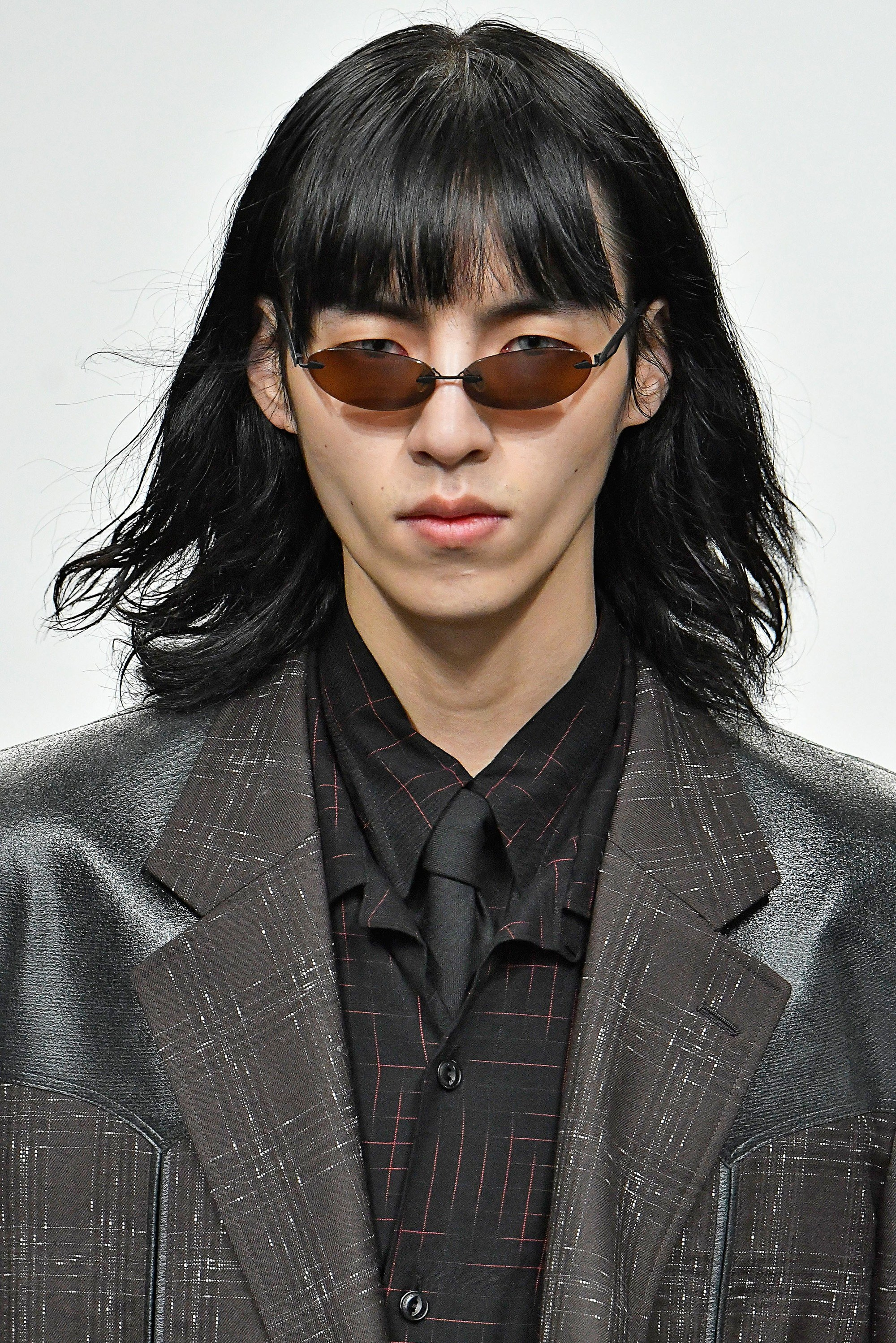 male model at john lawrence sullivan lfwm aw18 show with dark shoulder length hair with a fringe