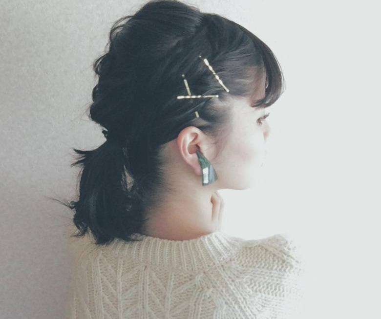 backshot of woman with low ponytail hairstyle with bobby pins
