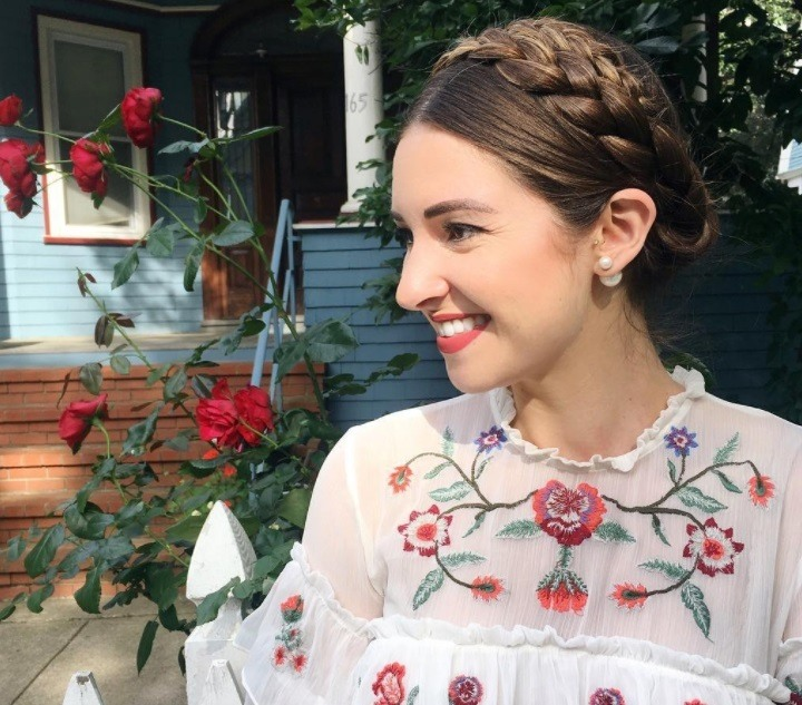 hairstyles for oily hair: woman with milkmaid braid hairstyle