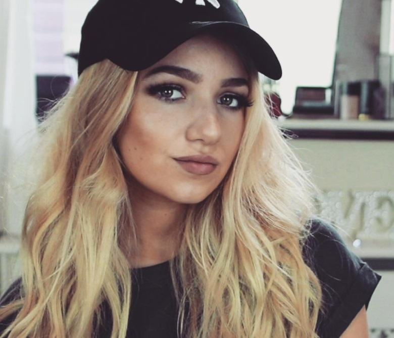 frontshot of girl with long blonde hair wearing a hat