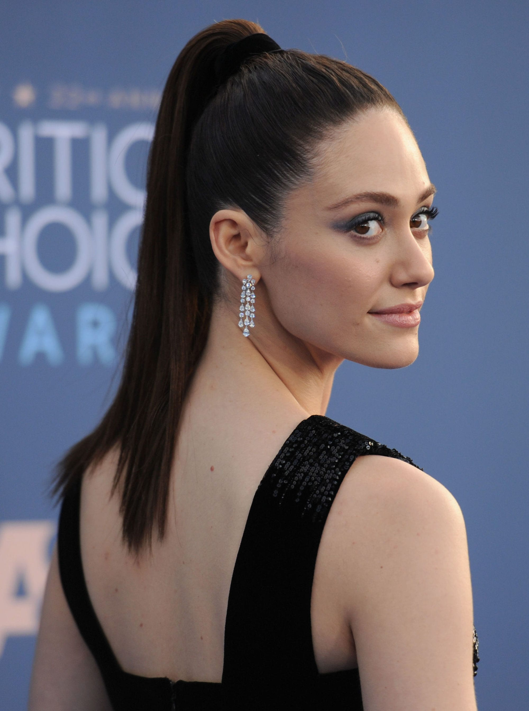 emmy rossum with high ponytail hairstyle on the red carpet
