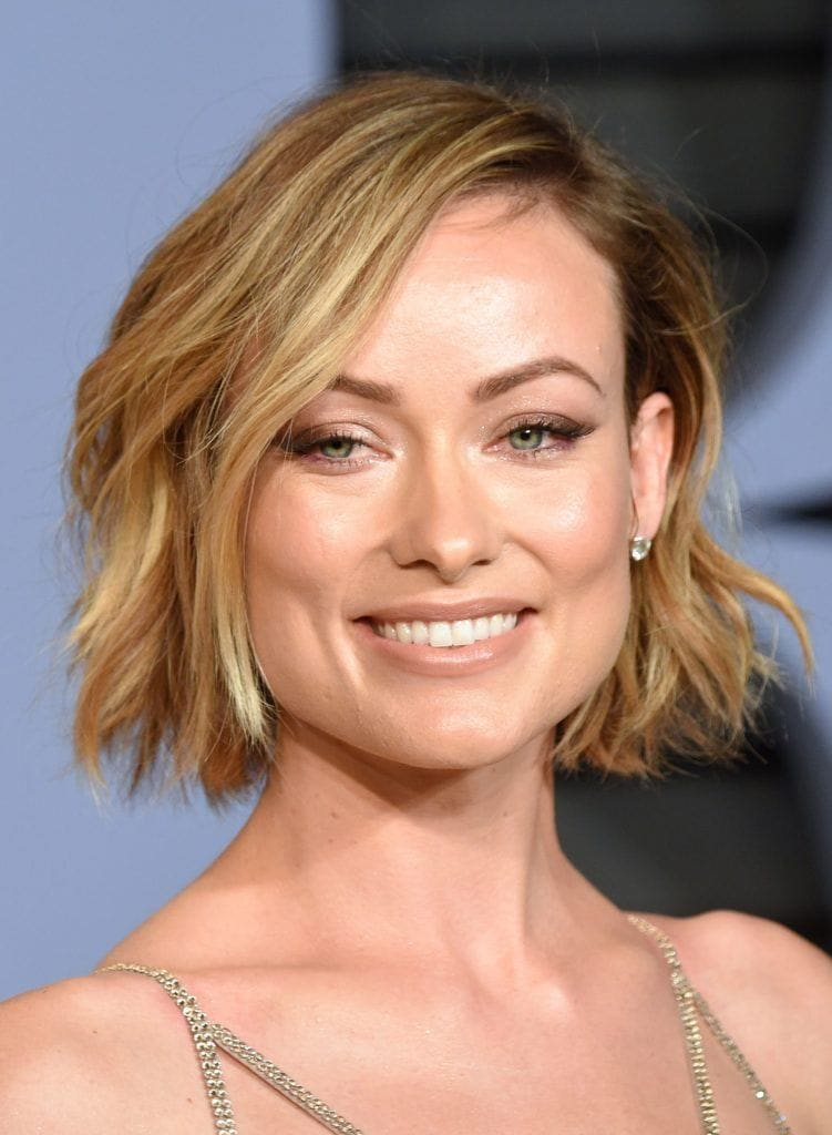 olivia wilde golden blonde hair styled in a side parting choppy bob