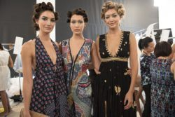models backstage at fashion week with pin curls