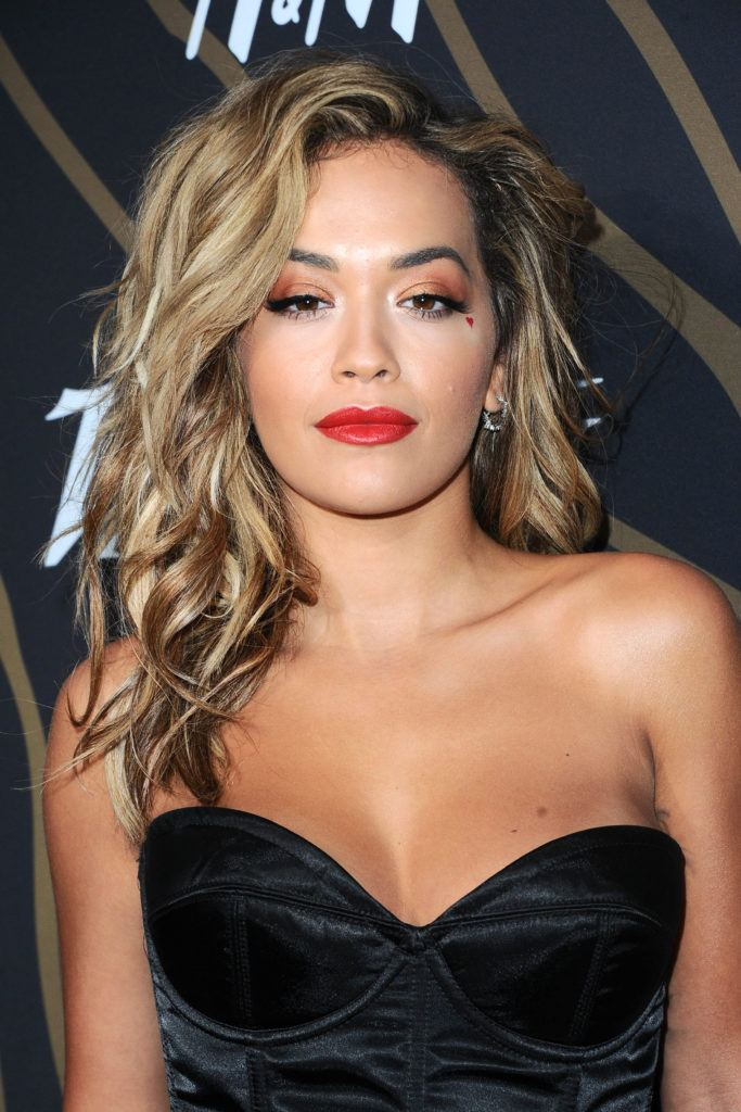 Rita Ora with her hair in waves with bronde hair colour