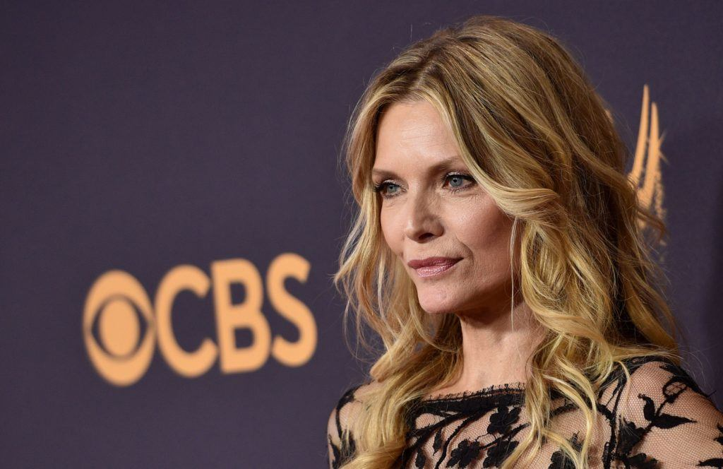 side view of Michelle Pfeiffer with her bronde hair colour in waves