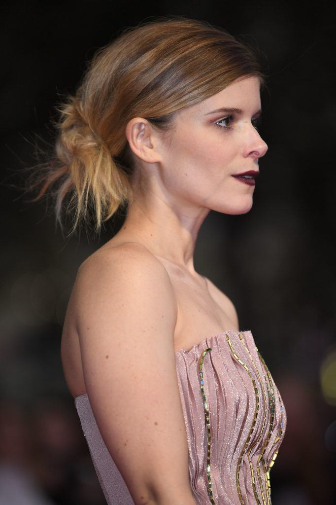 side view of a woman with her hair in a low bun with bronde hair
