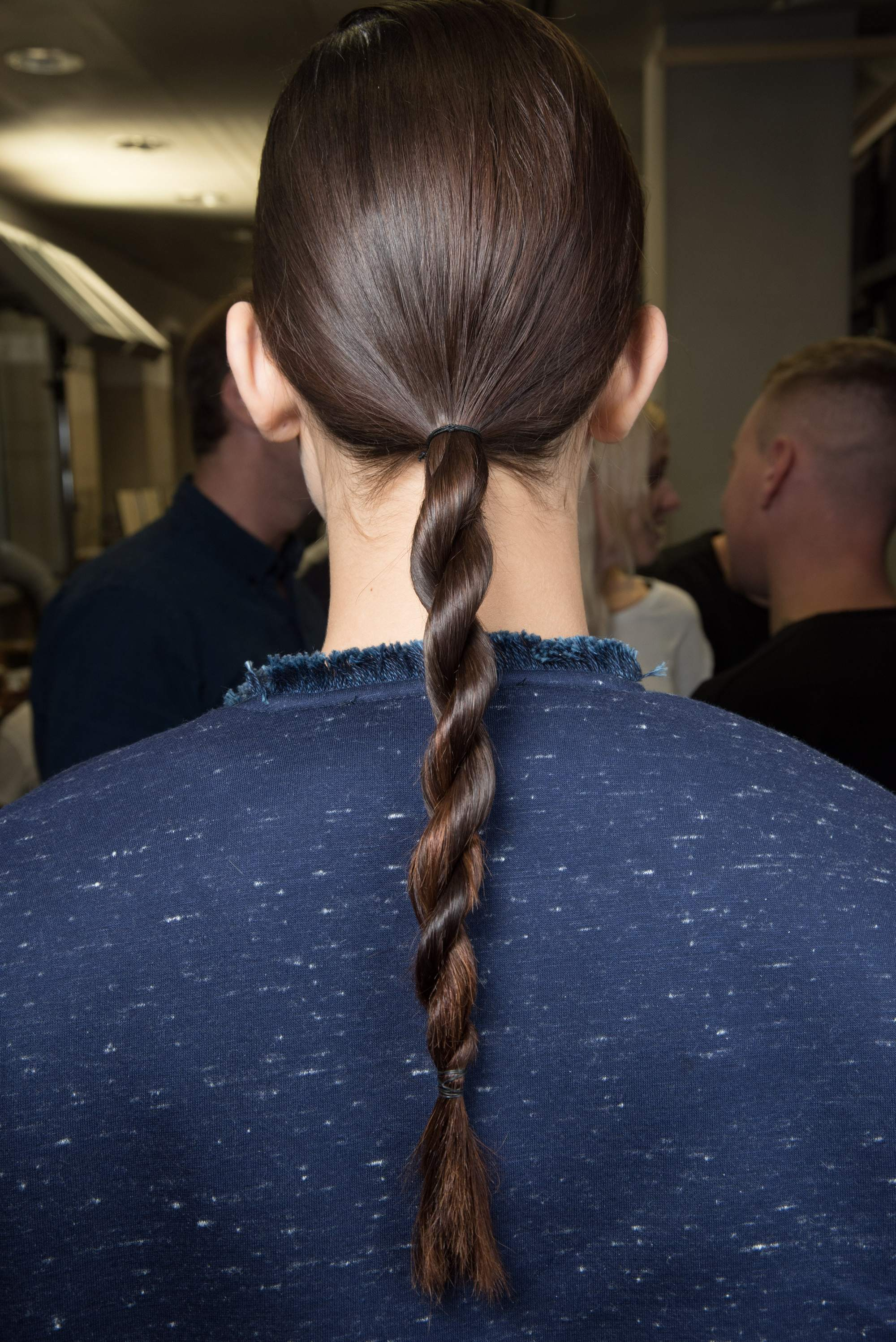 brunette model at the sportmax ss16 show with her hair in a twisted rope braid