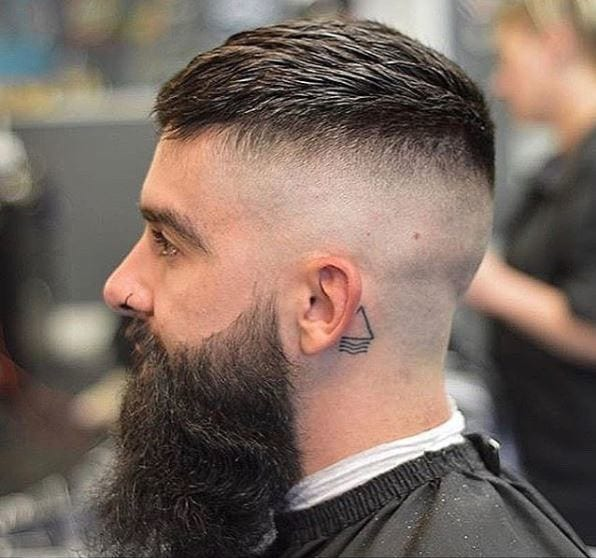 Dark haired man with skin fade and large beard