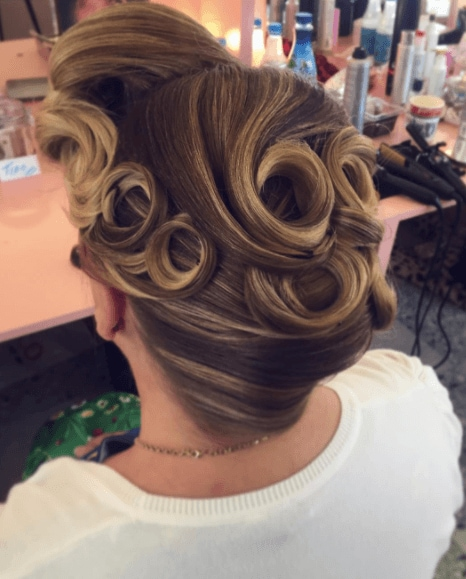 back view of womans hair with up 'do and pin curls