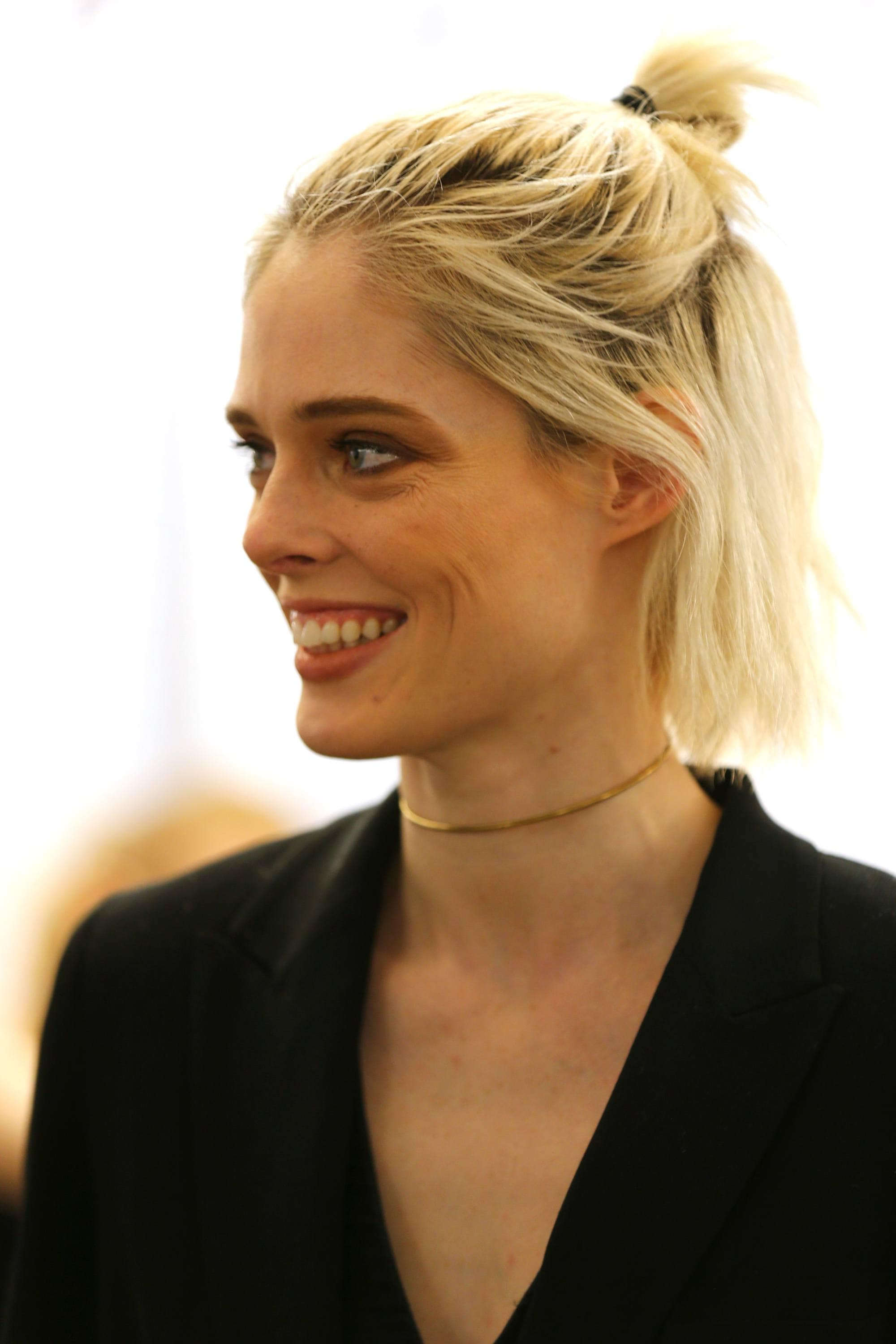 coco rocha with half up ponytail hairstyle backstage