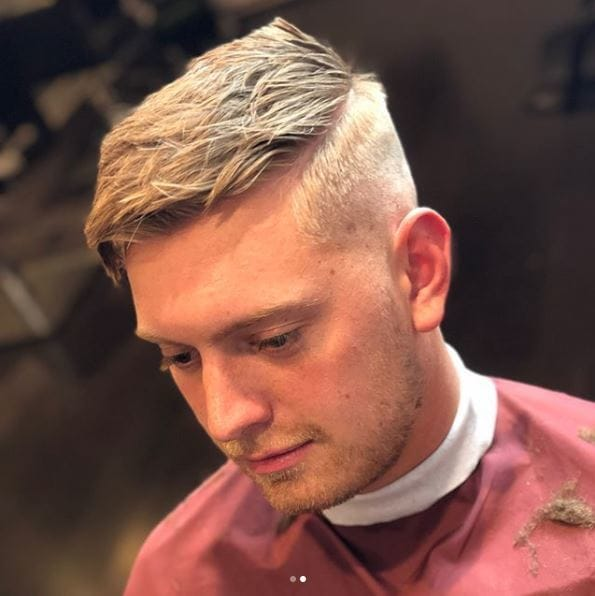 Blonde man with side parting and bald fade haircut