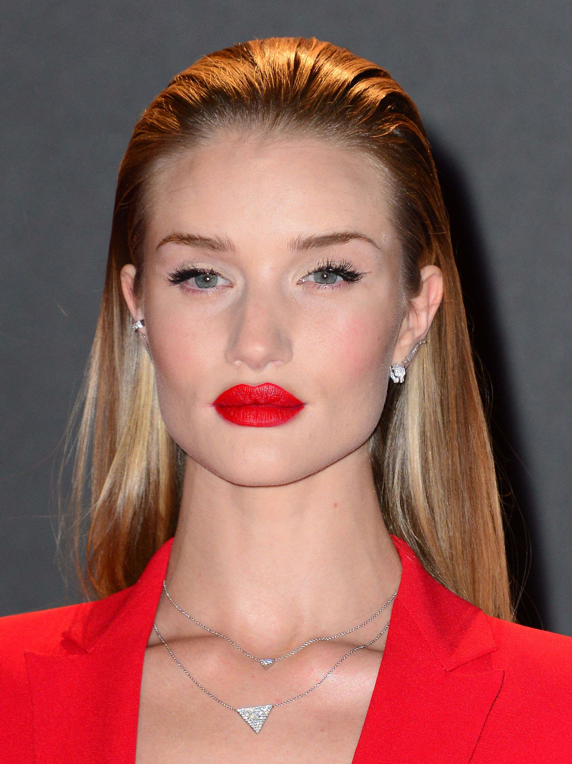 rosie huntington whiteley with slicked back faux undercut hairstyle on red carpet