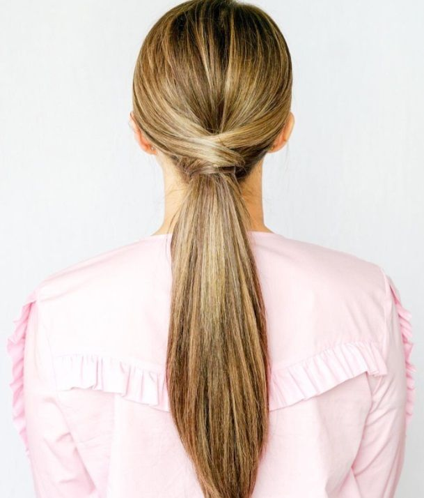 backshot of mother of the bride with ponytail sleek hairstyle