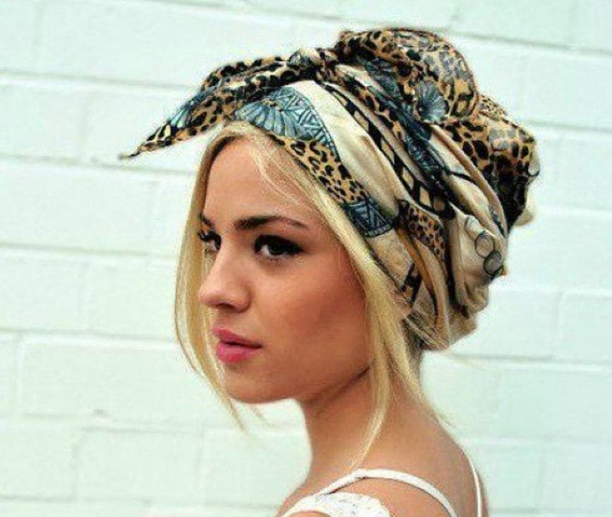 woman with printed scarf wrapped around her head