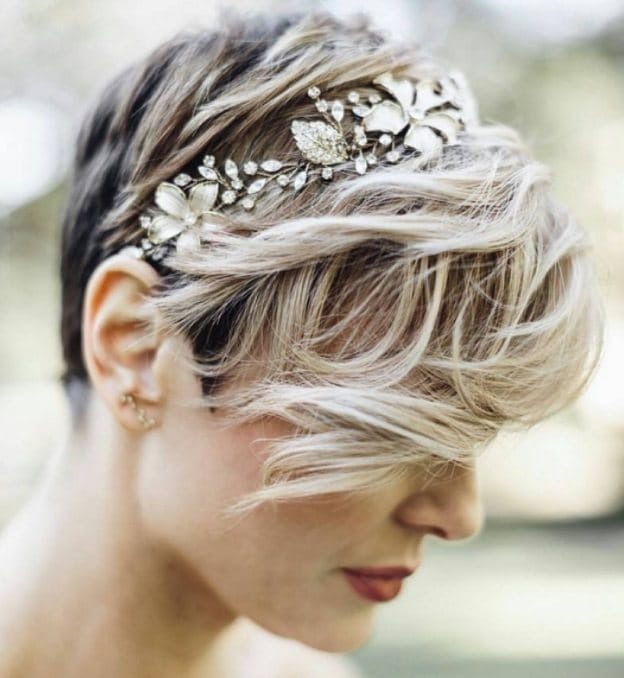 mother of the bride with pixie cut hair and glittery headband outside
