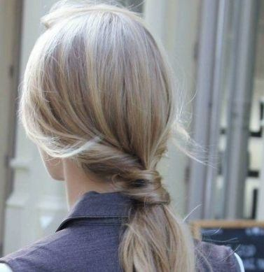 blonde woman with a twisted ponytail detail
