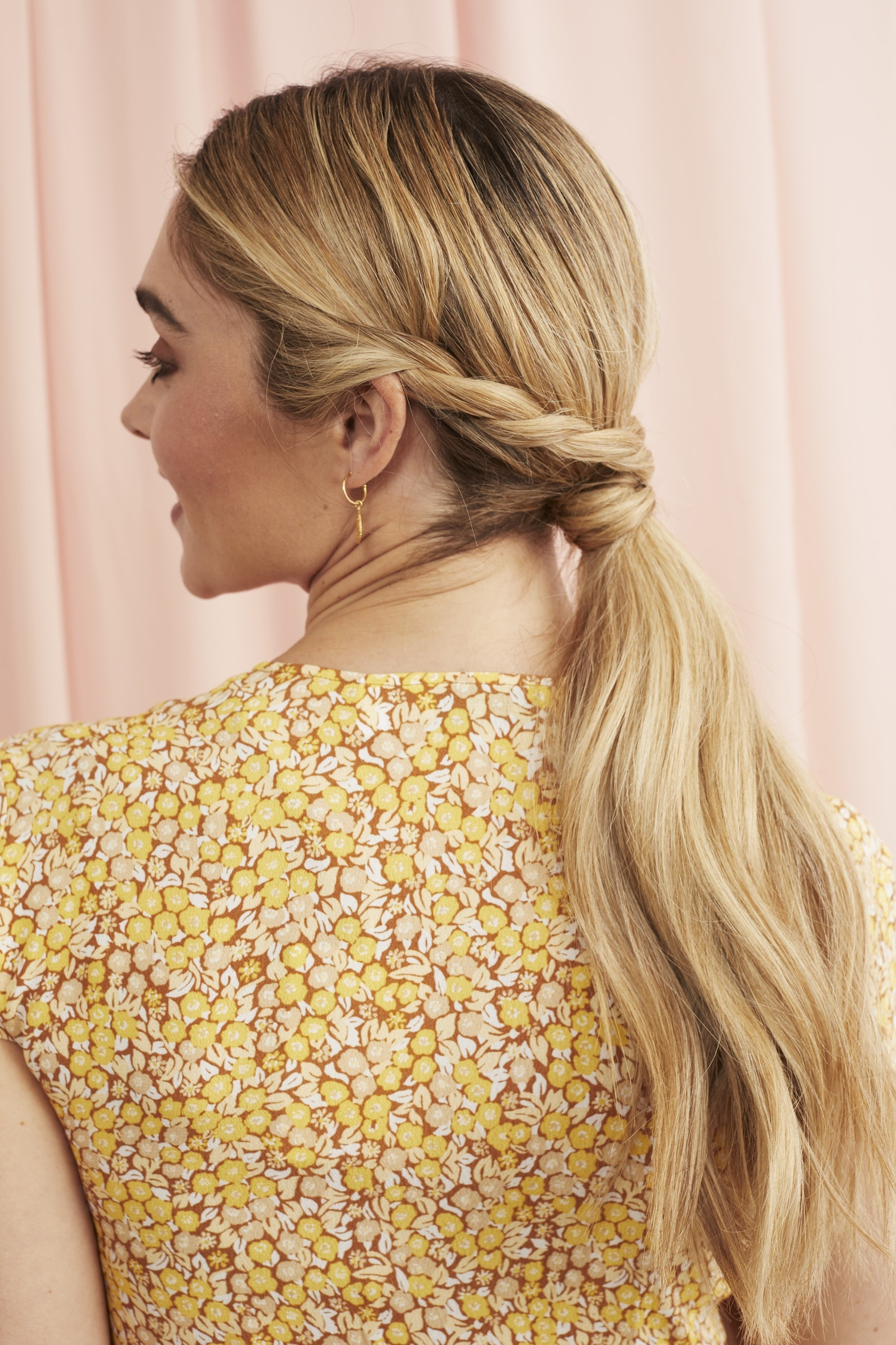 Blonde woman with a twisted low ponytail