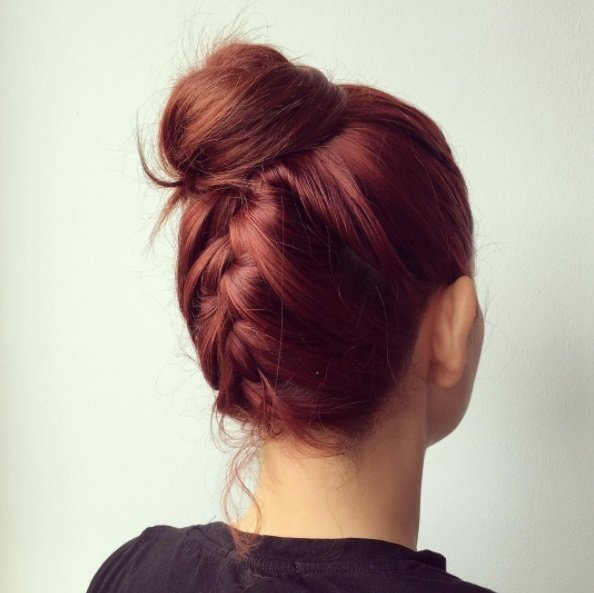 Wedding updos for long hair: Back shot of a woman with auburn hair in an upside down braid updo.