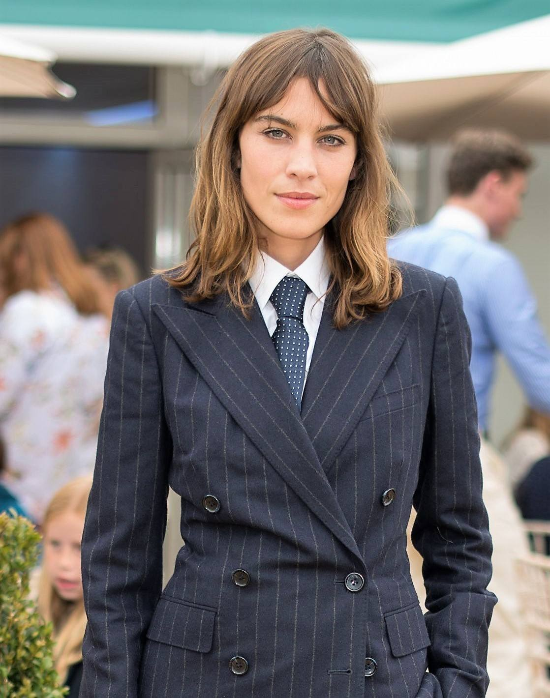 alexa chung at wimbledon 2017 with her medium length hair in tousled waves with split bangs