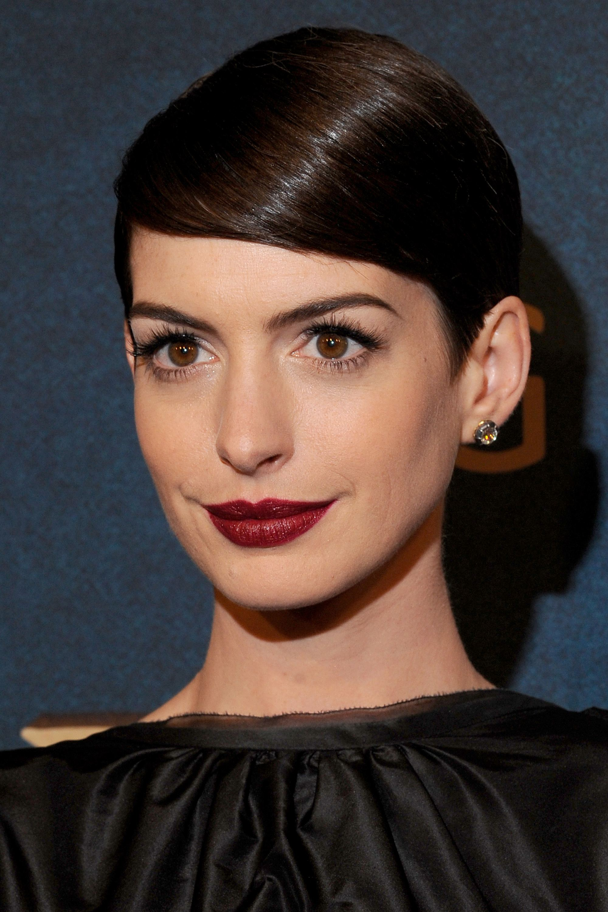 anne hathaway dark brown short pixie hair styled into sleek side fringe