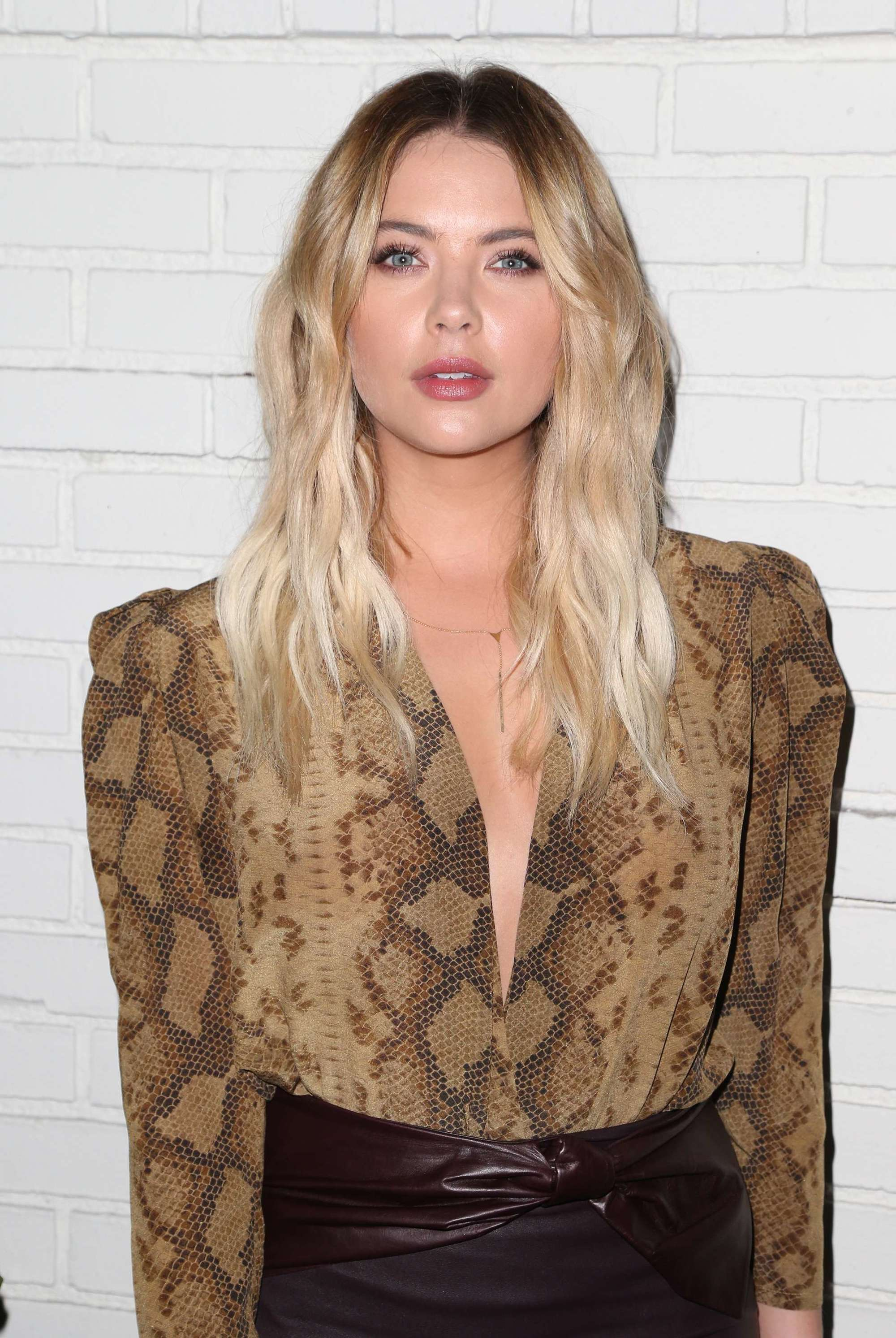Ashley Benson long blonde hair with dark roots and wavy finish