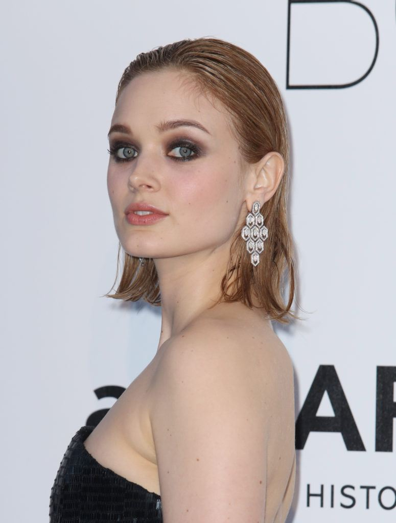 australian actress bella heathcote with her lob length blonde hair in a pushed back wet look style