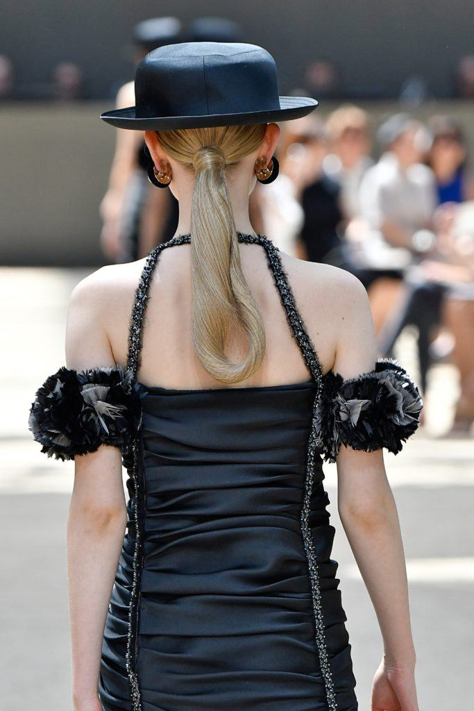 backshot of model with a netted low ponytail on the chanel paris haute couture runway 2017
