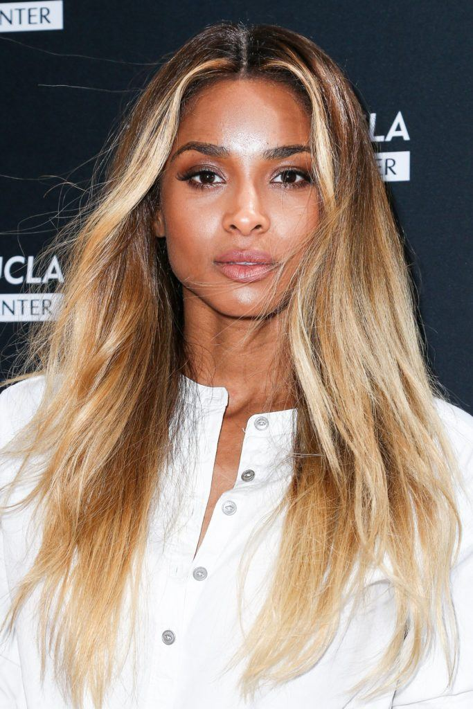 Ciara - long bronde hair with light wave in the mid-section