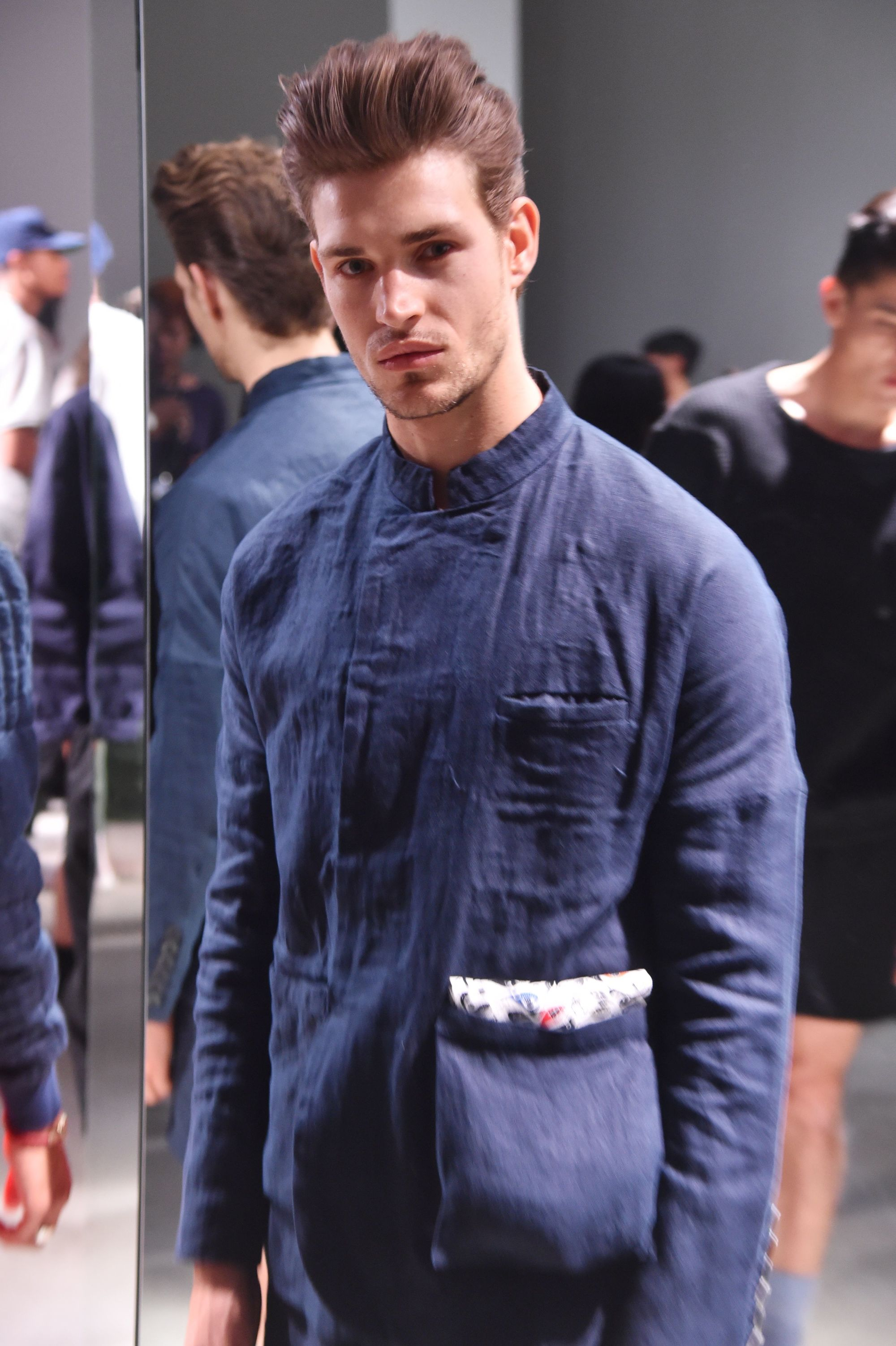 male model at the death to tennis nyfw mens presentation with a quiff hairstyle