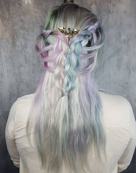 Game of Thrones hairstyles: Back view of a woman with silver and pastel dyed long Khaleesi hair with basket weave braids and a dragon hair accessory