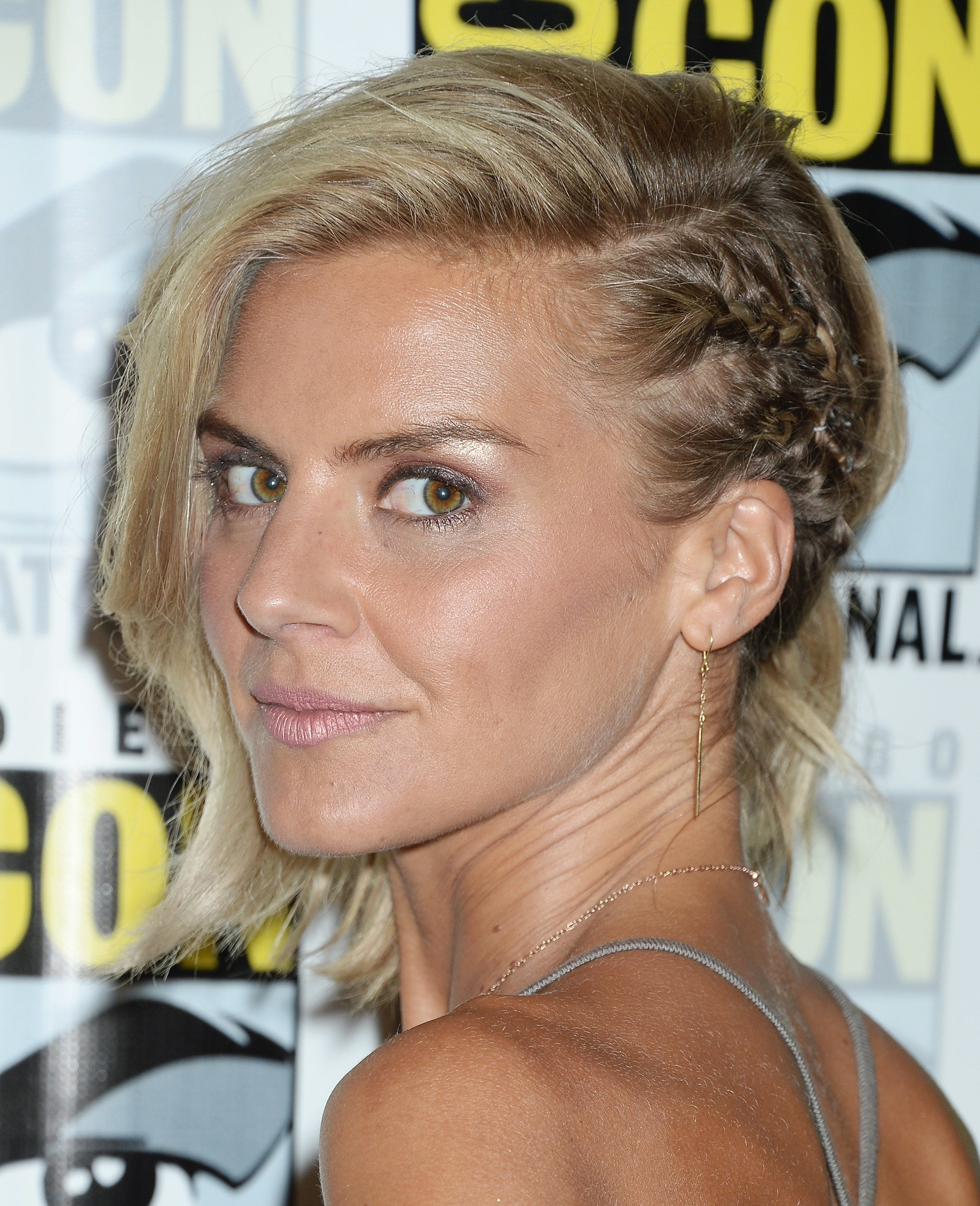 happy endings and scrubs star eliza coupe with her blonde hair in a braided undercut style