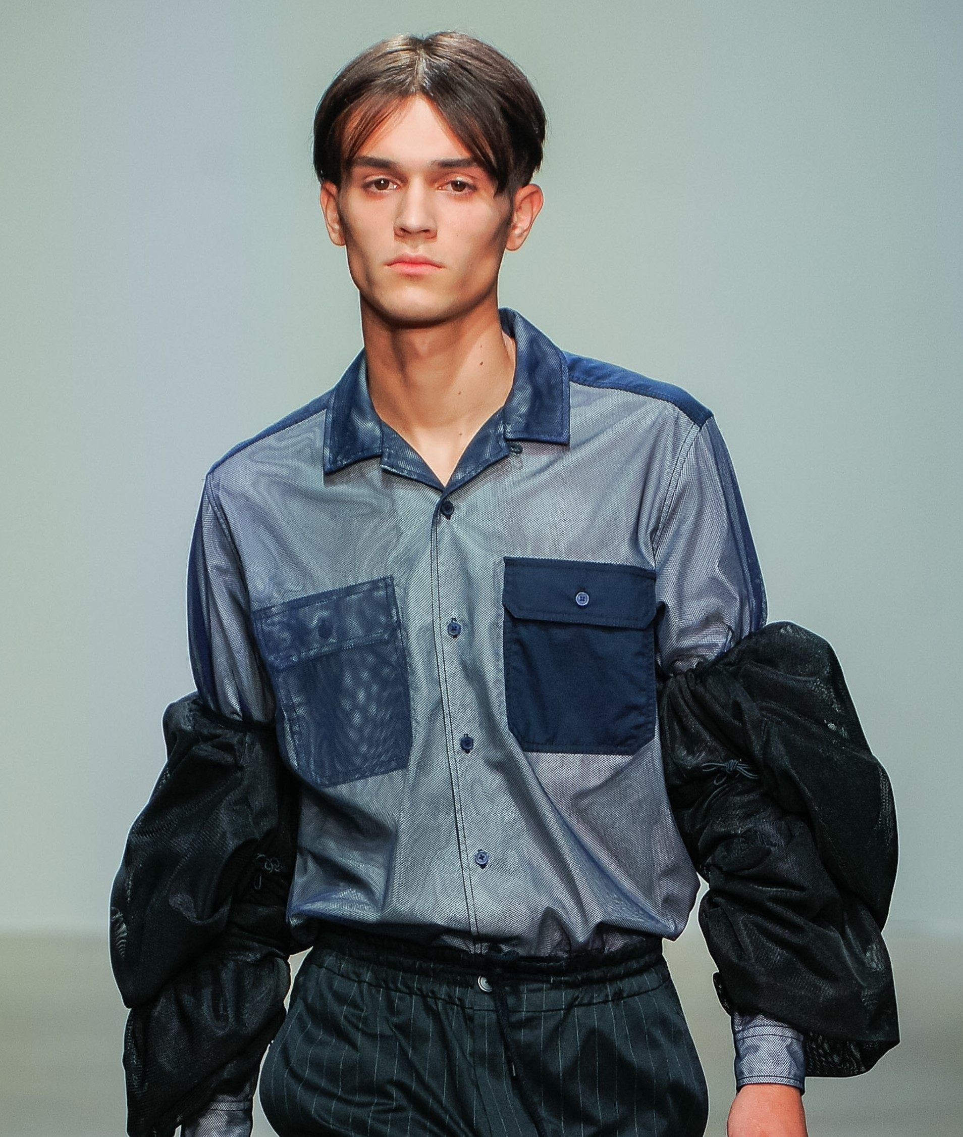 feng chen wang male model at the nyfw mens show with brunette 90s boyband curtain hair