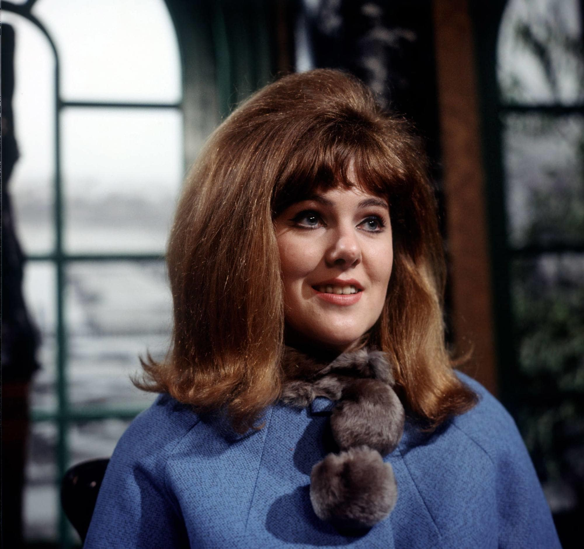 60s hairstyles: Lynne Redgrave with medium brown hair in mid length style with flipped ends