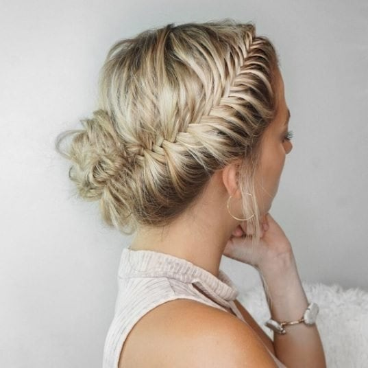 blonde woman with her hair in a french fishtail braid
