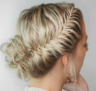 blonde woman with her hair in a french fishtail updo