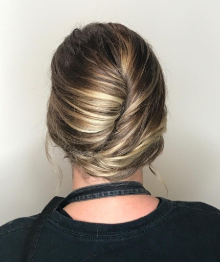 blonde woman with her hair in a french twist hairstyle