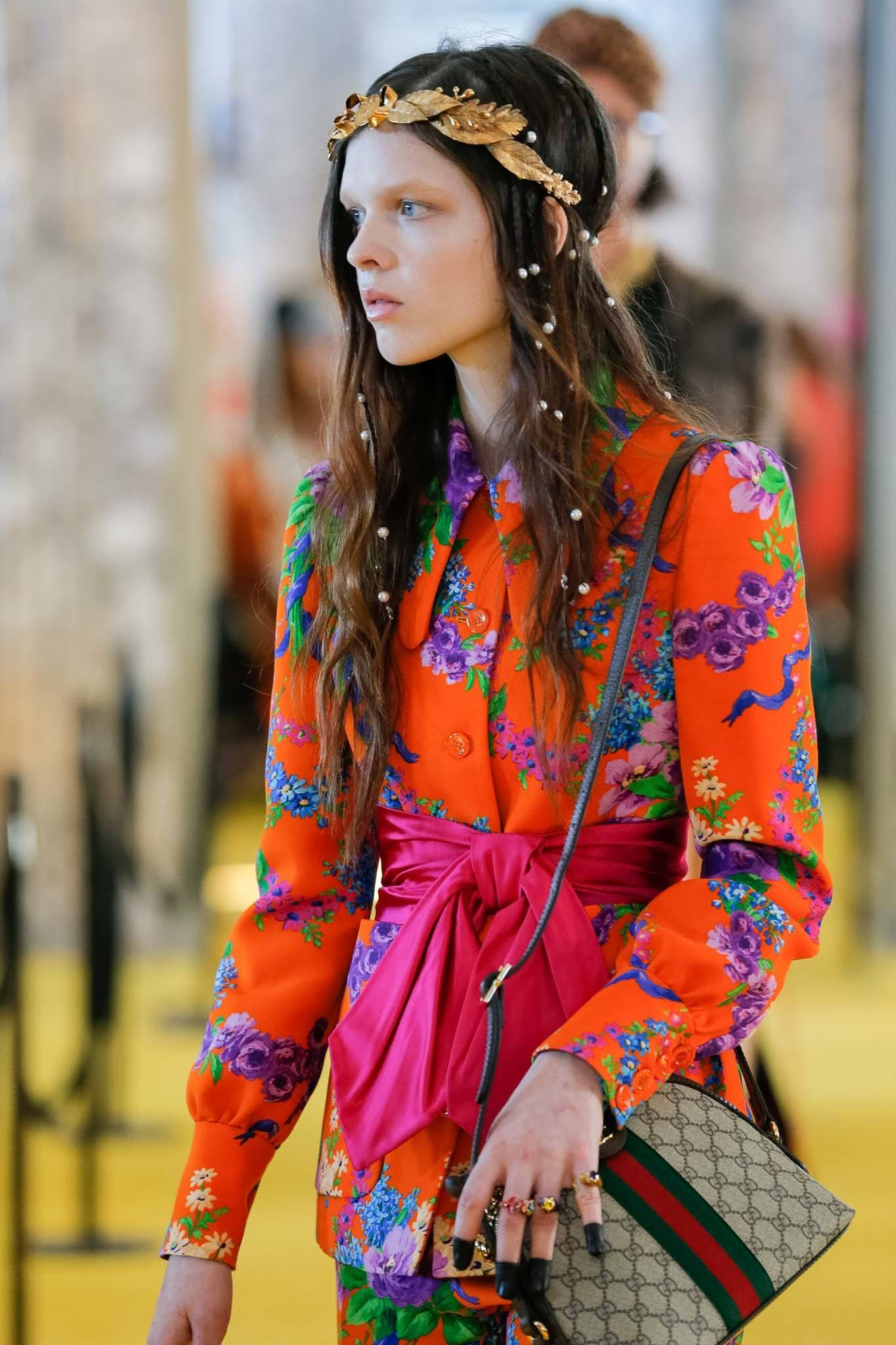 Gucci 2018 - long brown hair model with pearls placed through the length of hair