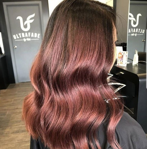 Red brown hair: Close up shot of a woman with long rose brown hair.